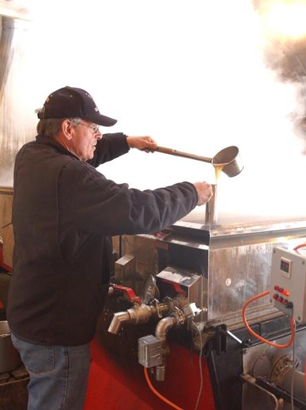 Ray Morvan of Sweet Retreat Sugarworks tests syrup